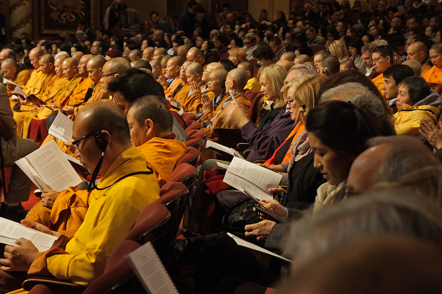 Members of the audience following the text during His Holiness the Dalai Lama's teachings at the Wang Center for the Performing Arts in Boston, MA, USA on October 30, 2014. Photo/Jeremy Russell