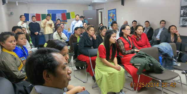 Tibetans living in Ottawa in Canada listen to a talk by Sikyong Dr. Lobsang Sangay in Ottawa on 26 Nov. 2014