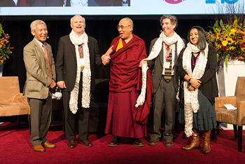 His Holiness's interpreter Thupten Jinpa, and panelists Arthur Zojonc, His Holiness the Dalai Lama, Richard Davidson and Amishi Jha at the conclusion of the 2nd International Symposium for Contemplative Studies organized by the Mind & Life Institute in Boston, MA, USA on October 31, 2014. Photo/Jurek Schreiner