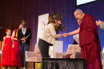 Young panelists arriving on stage to take part in a conversation with His Holiness the Dalai Lama as part of the SPARK 2014 program organized by the Dalai Lama Center for Ethics and Transformative Values at MIT's Kresge Auditorium in Cambridge, MA, USA on October 31, 2014. Photo/Fredo Durand