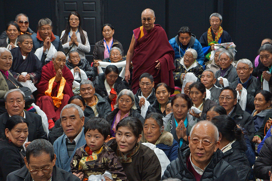 His Holiness the Dalai Lama with a group of elderly members of the Tibetan community during there meeting in Boston, MA, USA on November 1, 2014. Photo/Jeremy Russell/OHHDL