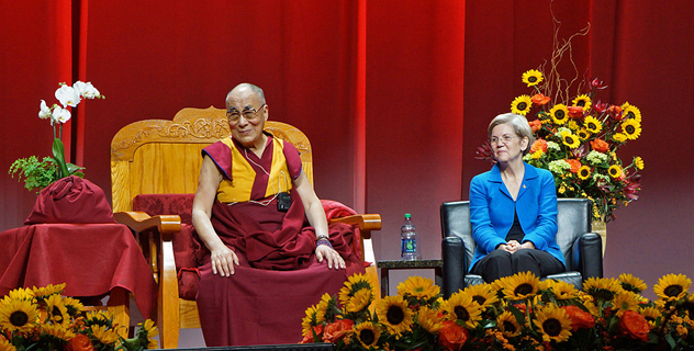 His Holiness the Dalai Lama and US Senator Elizabeth Warren watching members of the Tibetan community performing traditional songs at the start of his public talk in Boston, MA, USA on November 1, 2014. Photo/Jeremy Russell/OHHDL