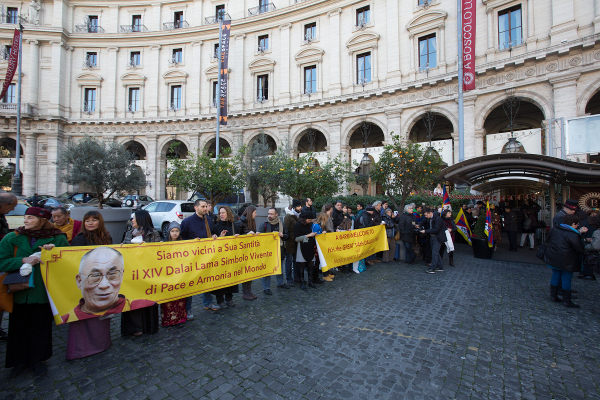 Tibetans and friends of Tibet await His Holiness the Dalai Lama's arrival in Rome, Italy.