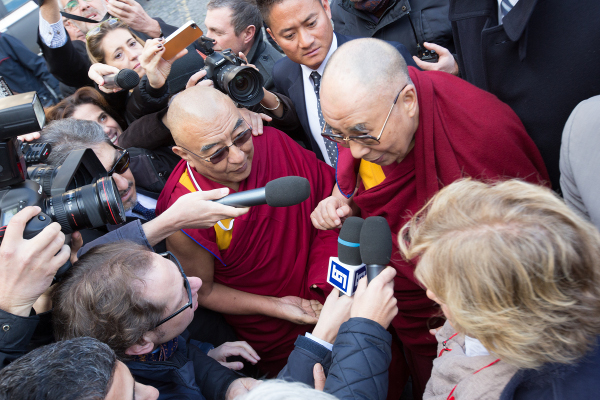 His Holiness the Dalai Lama being interviewed by press upon his arrival at the hotel, in Rome.