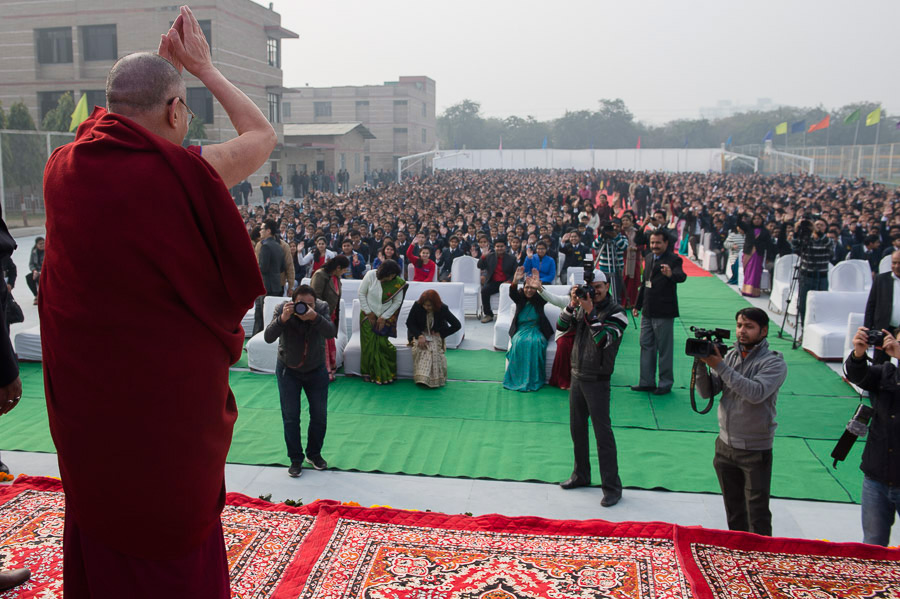 His Holiness the Dalai Lama greeting the gathered students and staff before his talk at the Dayanand Anglo-Vedic (DAV) School in Ghaziabad, UP, India on January 27, 2015. Photo/Tenzin Choejor/OHHDL