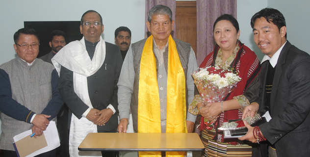 Home Kalon with the Chief Minister and Chief secretary accompanied by the Settlement officer