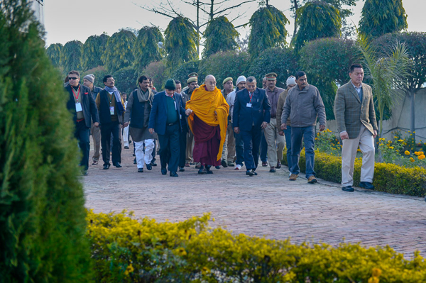 His Holiness the Dalai Lama walking from his hotel to visit a nearby Buddhist shrine during the second day of his three day visit to Sankisa, UP, India on January 31, 2015. Photo/Tenzin Choejor/OHHDL
