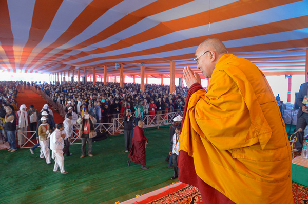 His Holiness the Dalai Lama greeting the crowd on his arrival at the Youth Buddhist Society's teaching venue in Sankisa, UP, India on January 31, 2015. Photo/Tenzin Choejor/OHHDL
