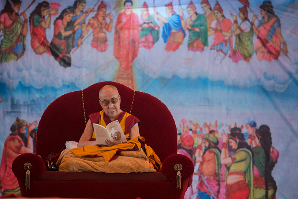 His Holiness the Dalai Lama reading from the Dhammapada during his teaching at the Youth Buddhist Society's teaching ground in Sankisa, UP, India on January 31, 2015. Photo/Tenzin Choejor/OHHDL