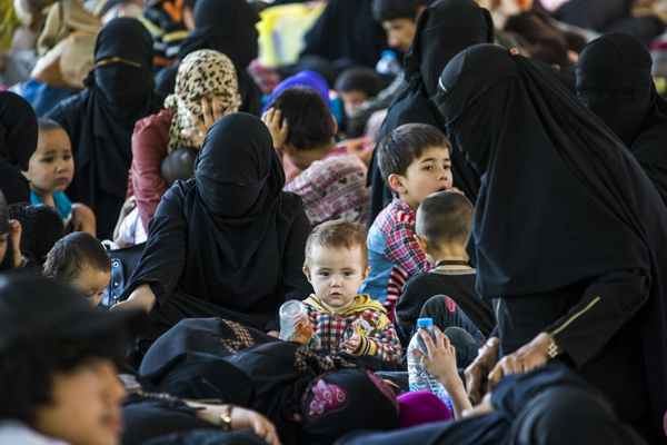 """Some Uighurs escape China via an """"underground railway"""" through Southeast Asia to Turkey. Here, families suspected of being Uighurs fleeing China rest after being detained by authorities in Thailand. Photo: Reuters"""