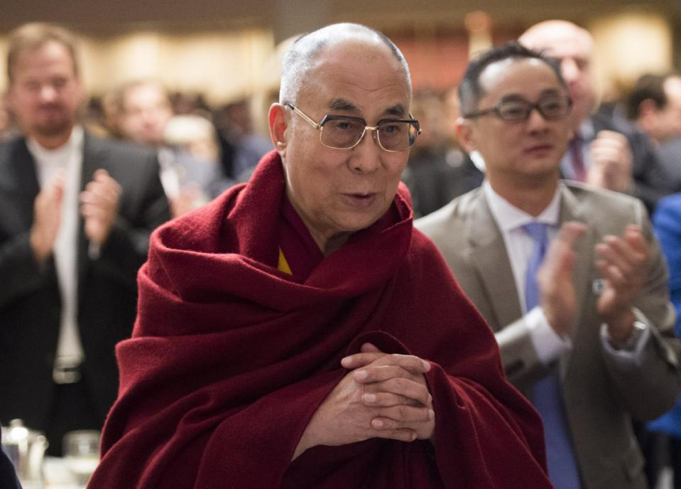 The Dalai Lama attends the National Prayer Breakfast in Washington, DC, February 5, 2015 (AFP Photo/Saul Loeb)