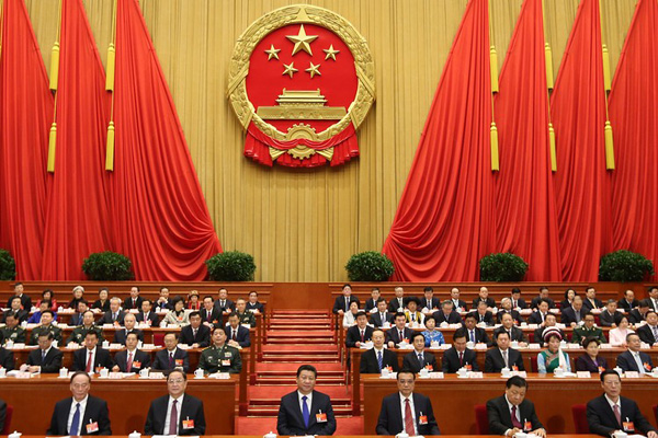 Chinese President Xi Jinping, front center, and other Chinese leaders attend the opening meeting on Thursday of the third session of the National People's Congress at the Great Hall of the People in Beijing. PHOTO: XINHUA/ZUMA PRESS