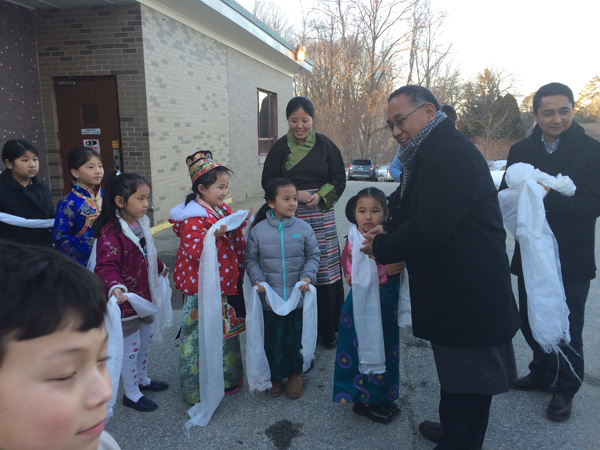 Education Kalon greeting schoolchildren during a visit to the Tibetan community in the US