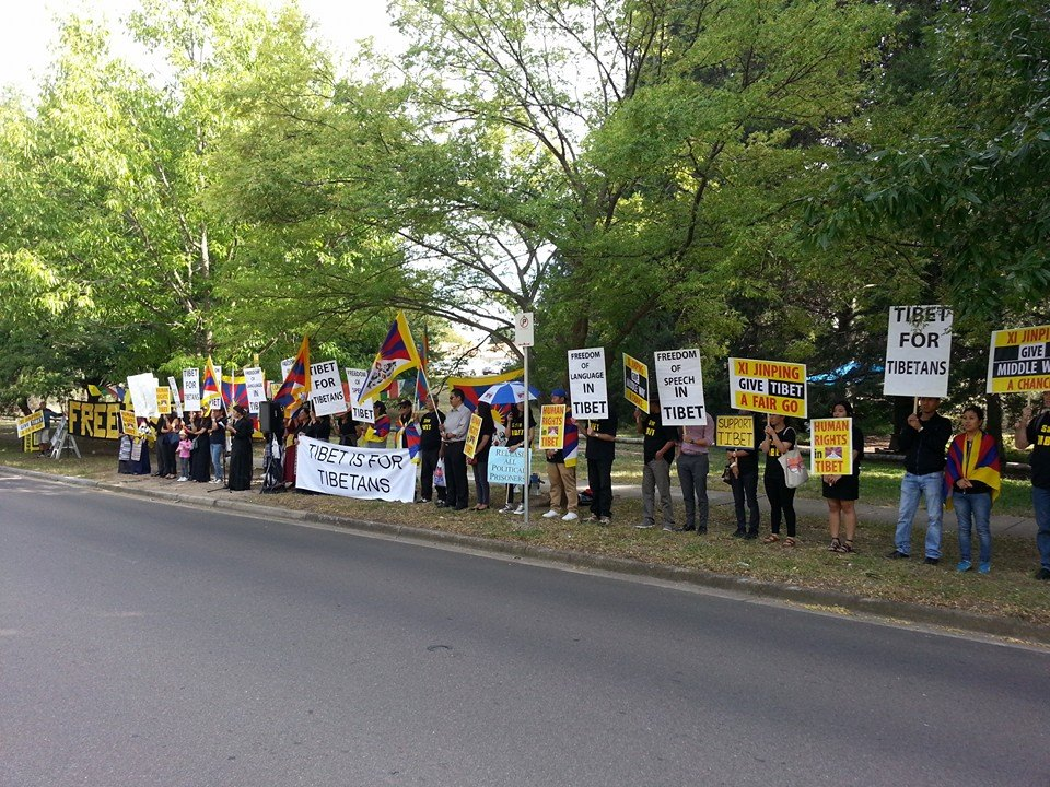Tibetans in the Australian capital Canberra holding a solidarity rally to commemorate the 56th Tibetan national uprising day.