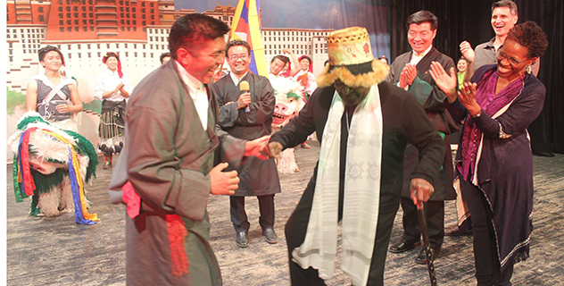 Archbishop Desmond Tutu dancing in delight after seeing the performances of the Tibetan artistes at the dinner recption organised by CTA in his honour.