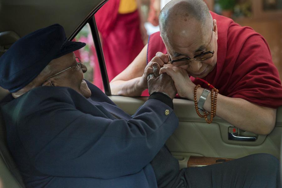 His Holiness the Dalai Lama saying goodbye to Archbishop Desmond Tutu    Young Desmond Tutu