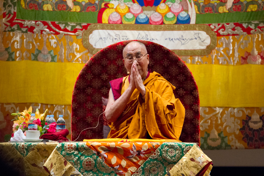 His Holiness the Dalai Lama joining in prayers at the conclusion of the first day of his two day teaching at Showa University Hall in Tokyo, Japan on April 12, 2015. Photo/Tenzin Jigmey