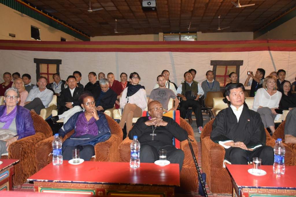 Archbishop Desmond Tutu, Sikyong Dr. Lobsang Sangay and the archbishop's daughter Mpho, watching the cultural show at TIPA on 22 April 2015.