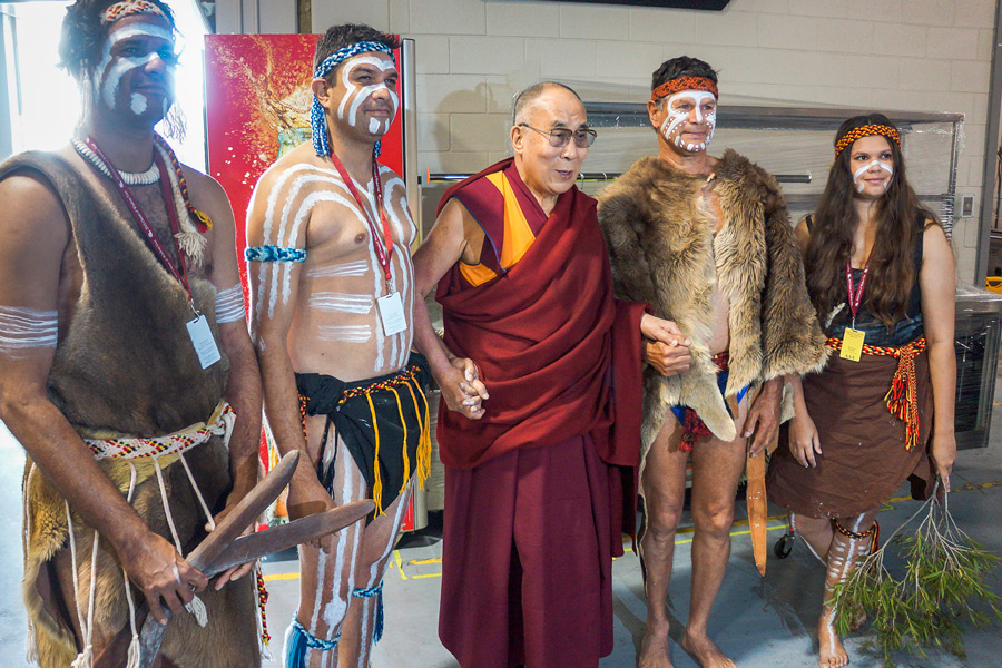 His Holiness the Dalai Lama with indigenous dancers who performed before his talk at the Perth Arena in Perth, WA, Australia on June 14, 2015. Photo/Jeremy Russell/OHHDL