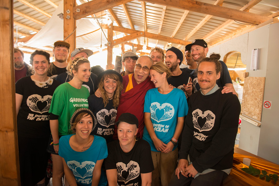 His Holiness the Dalai Lama posing for a photo with Greenpeace volunteers during his visit to the Glastonbury Festival in Glastonbury, Somerset, UK on June 28, 2015. Photo/Nick Wall