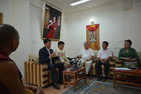 Sikyong Dr. Lobsang Sangay and Sikyong scholarship recipient Tenzin Damdhul with officials from the education department.