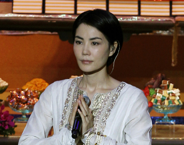 FILE - In this April 26, 2012 file photo, Chinese pop singer Faye Wong, also known as Wang Fei, performs during the opening ceremony of the third World Buddhist Forum in Hong Kong. China's state media have criticized celebrities for attending an event on Feb. 14, 2016 in northern India with members of the Tibetan government-in-exile, adding to Chinese authorities' warnings about how actors and singers must behave. (AP Photo/Kin Cheung, File)