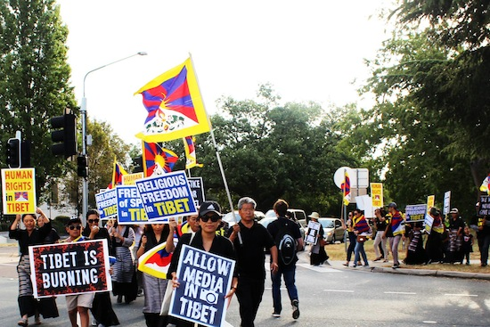 Tibetans at the raly to commemorate 57th Tibetan National Uprising Day.