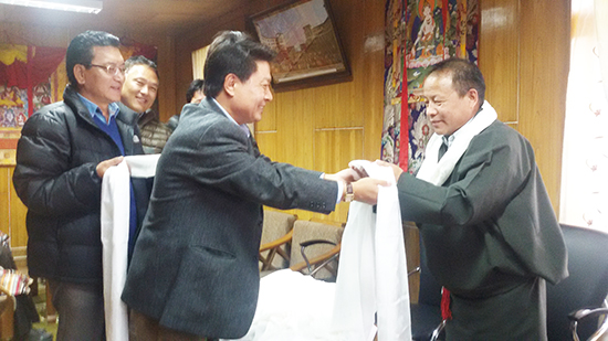 DIIR Secretary Mr Tashi Phunstok greeting Mr Tsegyal Dranyi, he new Secretary of Department of Religion and Culture.