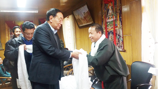Kalon Pema Chhinjor greeting Mr Tsegyal Dranyi, the new secretary of the Department of Religion and Culture, 17 March 2016.