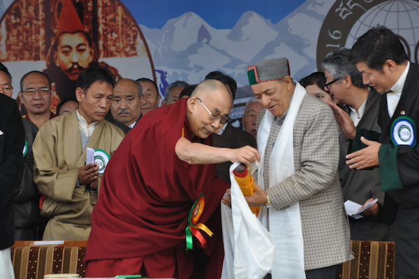 His Holiness the Dalai Lama presenting souvenir to Sri Thakur Singh Bharmouri, the Forest minister of Himachal Pradesh.