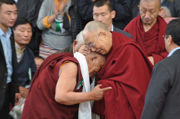 His Holiness the Dalai Lama embracing Dr Yeshi Dhonden during the ceremony.