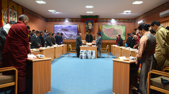 Members of the Tibetan Parliament and the Kashag observing a minute's silence as a mark of respect for the Tibetan self-immolators who sacrificed their lives for the cause of Tibet.