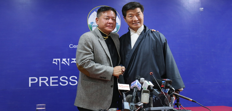 In a show of unity and affection, the two final candidates hugged and posed for photographs at the end of the joint press conference.