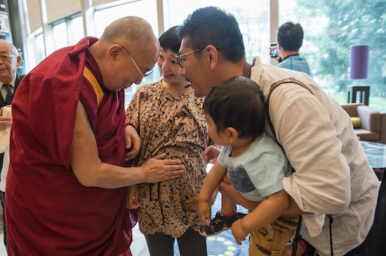 HIs Holiness the Dalai Lama blesses a young pregnant lady with her husband before leaving from Hilton Hotel, Narita to Osaka, 9 May 2016. Photo/Tenzin Choejor/OHHDL