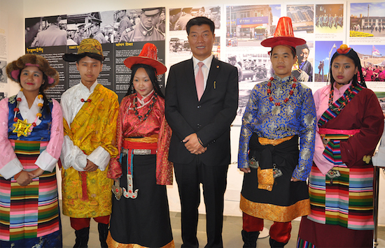 Sikyogn dr lobsang Sangay with a group of Tibetan school children in traditional Tibetan costumes.