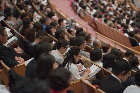 Members of the audience following the text during the second day of His Holiness the Dalai Lama's four day teaching in Osaka, Japan on May 11, 2016. Photo/Tenzin Choejor/OHHDL
