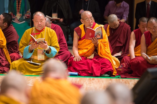 Members of the monastic community following the text during the second day of His Holiness the Dalai Lama's four day teaching in Osaka, Japan on May 11, 2016. Photo/Tenzin Choejor/OHHDL