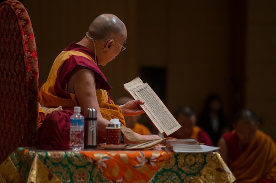 His Holiness the Dalai Lama reading from the text during the second day of his four day teaching in Osaka, Japan on May 11, 2016. Photo/Tenzin Choejor/OHHDL