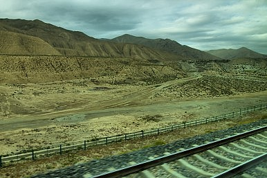 Image Credit: Tibet railroad image via Shutterstock.com