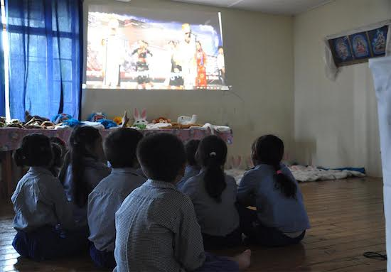 Children of Norling Creche and Kindergarten watching the Tibetan nursery rhymes created by Mr Chodak, 24 June 2016.
