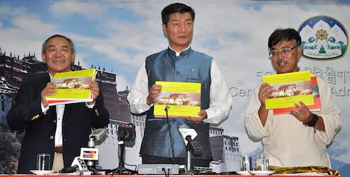 Sikyong and Education Kalon Dr Lobsang Sangay, Education Secretary Dr Ngawang Rabgyal and Director Mr Tsering Samdup releasing the textbooks for Tibetan children in North America, 30 June 2016.