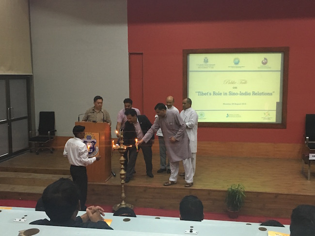 Deputy Secretary of Tibet Policy Institute along with the distinguished speakers lighting the auspicious butter lamp before the talk.