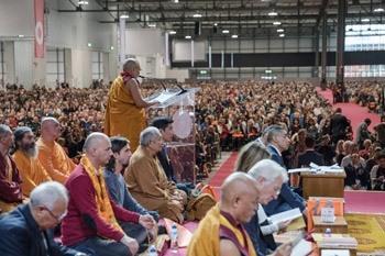 Thamthog Rinpoche introducing His Holiness the Dalai Lama to the 8800 strong crowd at the start of teachings in Milan, Italy on October 21, 2016. Photo/Tenzin Choejor/OHHDL