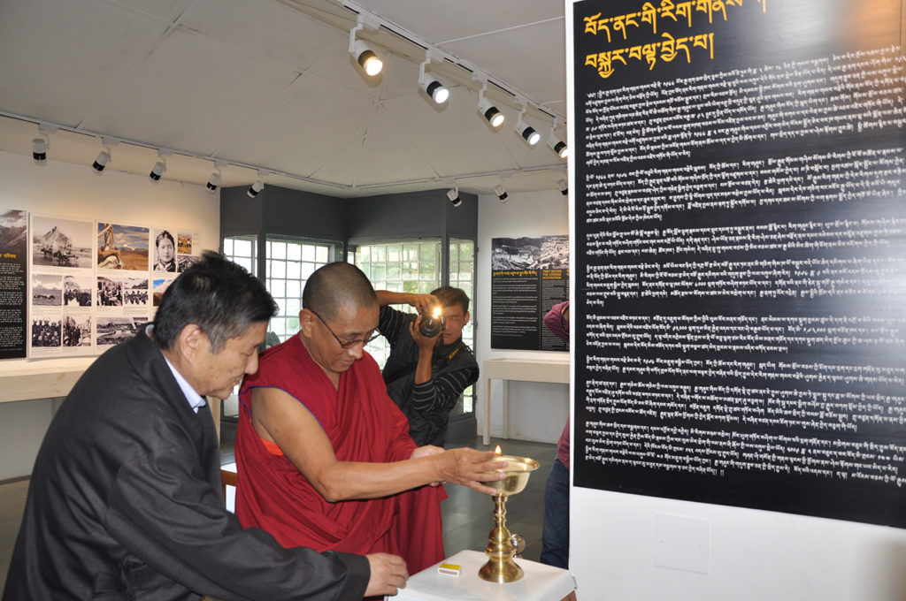 Kalon Karma Gelek Yuthok Lighting the Tibetan butter lamp and inaugurating a photo-framed exhibition cum panel discussion titled 'Revisiting the Cultural Revolution in Tibet' at the Tibet Museum with Mr Sonam Norbu Dagpo, Secretary for International Relations. Photo/Tenzin Phende/DIIR