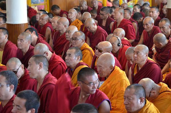 Buddhist monks listening to His Holiness' teaching of