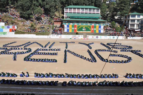 Student performing a callisthenic display highlighting the theme of this year's anniversary 'Unity is Strength'.