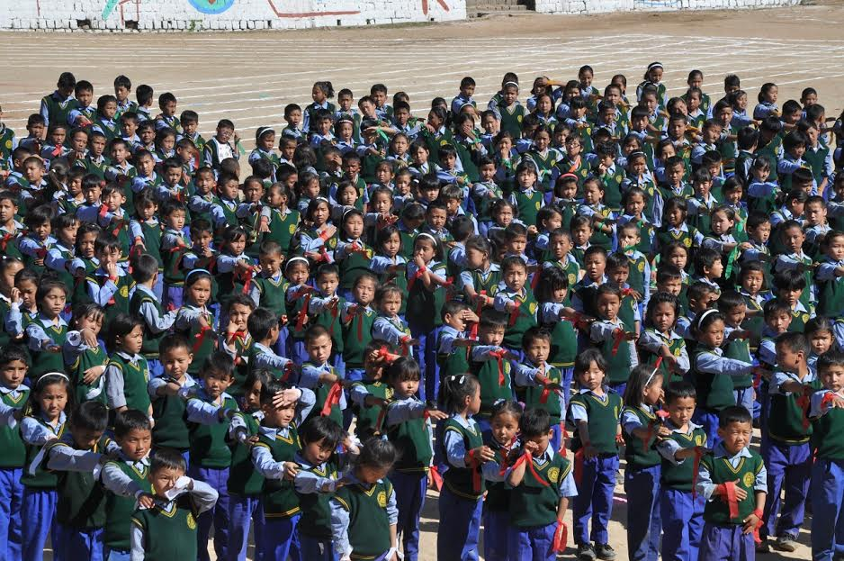 Around 300 children performing a group song
