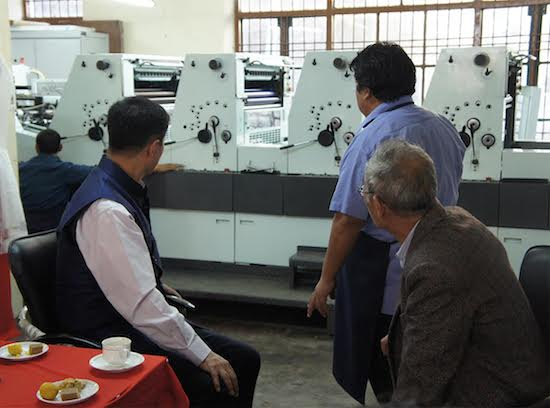 Sikyong Dr Lobsang Sangay and Director of TPI Mr Thubten Samphel observing the new printing press, Delta - 664.