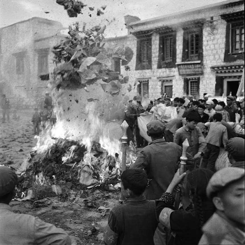 Numerous religious scriptures and religious texts are engulfed in flame near Jokhang Temple, Lhasa. These scriptures are sacred Buddhist texts and commentaries that were once part of the sacred and priceless literature collection of the monasteries of Tibet.