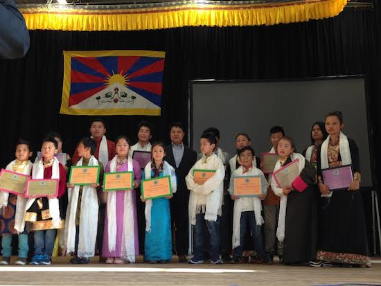 Representative Tashi Phuntsok with the students who were awarded prizes for their outstanding performances.
